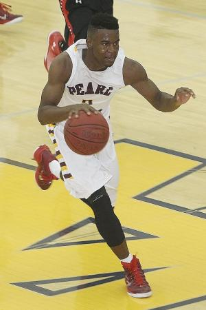 Pearl River's Cortez Mitchell drives the court