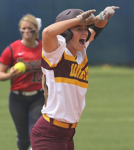 Pearl River's Brooke Roberts is obviously elated after belting a sixth inning RBI double for the Lady Wildcats