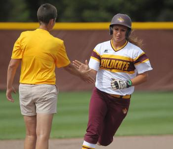 Pearl River's Dani Barton gets a congratulatory 'high five' from head coach Leigh White