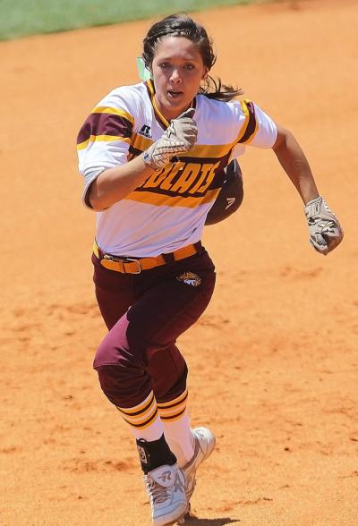 Pearl River's Branda Northrop races to third before heading home for a run