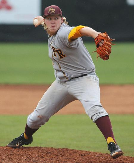 Pearl River's Jordan Hayes delivers a pitch in the Wildcats' 10-5 victory over archrival Mississippi Gulf Coast