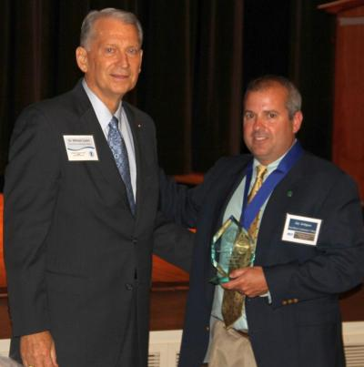 PRCC President William Lewis (left) presents Jay Artigues with his Sports Hall of Fame award