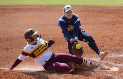 Ramee Taylor slides across home plate safely
