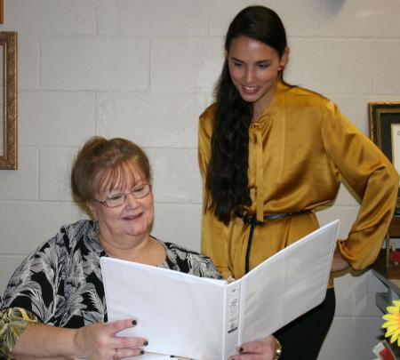 Rachael Carraro (standing) looks over her class work with advisor Dr. Terri Ruckel