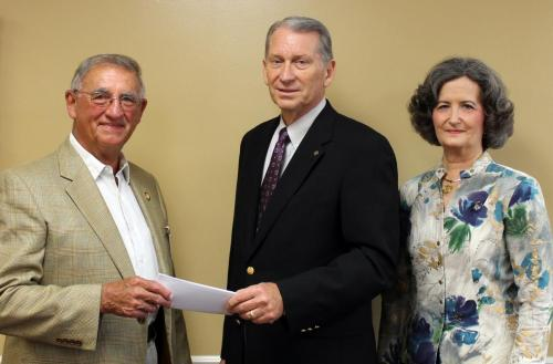 Dr. Lewis receiving grant for Women's Health Symposium