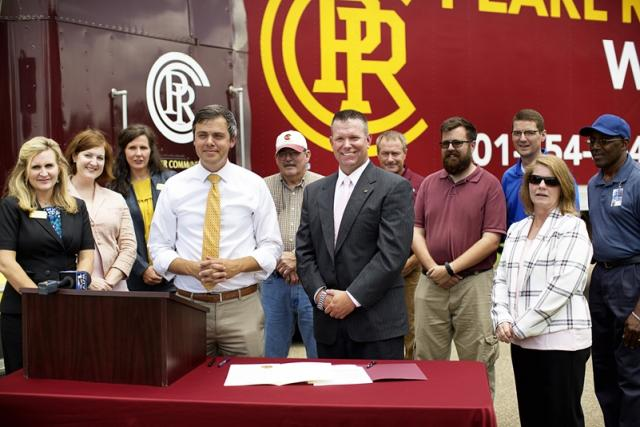 Toby Barker, Mayor of Hattiesburg, and PRCC President, Dr. Adam Breerwood, announce a partnership between the City of Hattiesburg and PRCC providing CDL training for city employees. They are joined by other PRCC representatives and city officials.