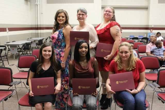 CNA graduates celebrate at their graduation with family and friends
